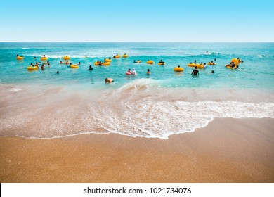 Jeju Island, South Korea - August 18, 2015: Lots of children and their parents swimming in the sea - Jeju Island, South Korea