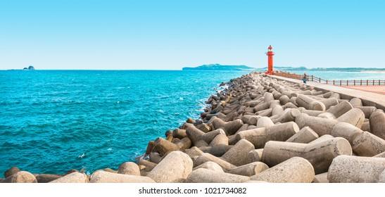 JEJU ISLAND, SOUTH KOREA - AUGUST 18, 2015: Panoramic shot of seascape with lighthouse in Jeju Island - South Korea