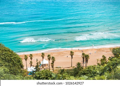 Jeju Island, South Korea - August 18, 2015: Areal shot of beautiful beach with enthusiastic people learning how to surf at Jeju Island - South Korea