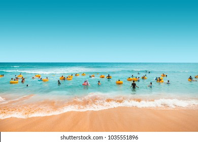 Jeju Island, South Korea - August 18, 2015: Many children and their parents swimming in the sea - Jeju Island, South Korea