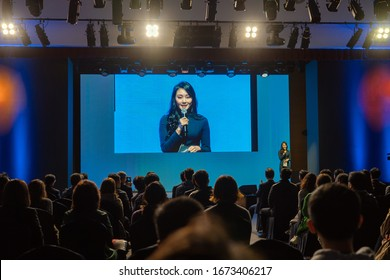 JEJU ISLAND, SOUTH KOREA - NOVEMBER 3, 2018. The Host of Special Event while Audience is Watching the Presentation. Pretty Asian Lady Having Speech on the Stage.