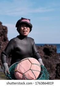 Jeju Island, Jeju / South Korea - October 27 2019: A Haenyeo fishing lads prepares to enter the sea on Jeju island