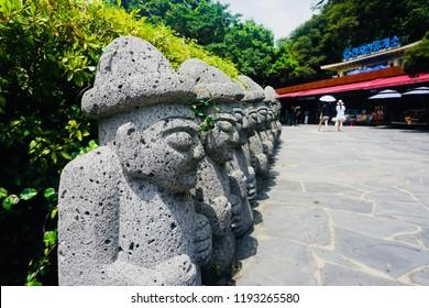 """Jeju, Jeju/Korea - July 30, 2018: A raw of Statue called 'dol hareubang' that mascot of Jeju island"""