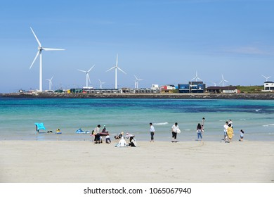 Jeju, Korea - May 22, 2017: Woljeongri beach. The beach is famous for clean and fine white sand. In addition, beachfront cafe streets have made the beach more famous in recent years.