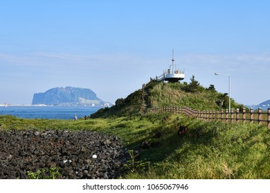 Jeju, Korea - May 22, 2017: Jongdalri coast trail in Jeju island, Korea. The trail is famous for beautiful scenery. In the walkway there is an observation platform made of an old ship.