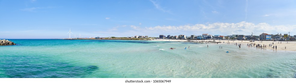Jeju, Korea - May 22, 2017: Woljeongri beach and Cafe Street. The beach is famous for clean and fine white sand. In recent years, beachfront cafe streets have made the beach more famous.