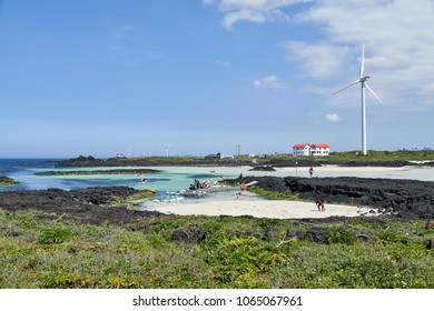 Jeju, Korea - May 22, 2017: People kayaking in Woljeongri coast. Worljeongri coast is famous for clean white sand and emerald-blue water. And also many people enjoy kayaking at the coast.