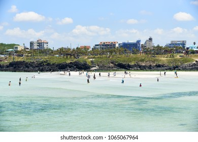 Jeju, Korea - May 22, 2017 : Hamdeok beach and costal landscape in Jeju island, Korea. The Beach is famous for its clean and emerald-blue water and white sand.