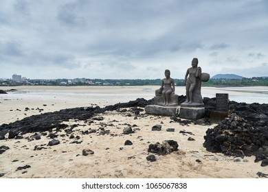 Jeju, Korea - May 24, 2017: Olle course No.3 and Pyoseon Haevichi beach with Statues of Haenyeos. It is famous for its white sand formed out of broken shells and shallow water.