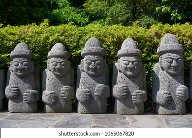 Jeju, Korea - May 25, 2017: Dol Hareubang, local traditional large rock statues. They are considered to be gods offering protection and fertility and were placed outside of gates.