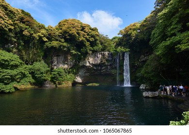 Jeju, Korea - May 25, 2017: Cheonjiyeon waterfalls, one of the most famous waterfalls on Jeju Island. The waterfall is 22m high and the name means 'sky connected with land'.