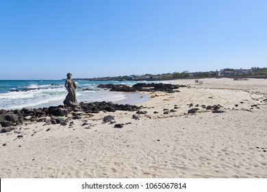 Jeju, Korea - May 26, 2017: Gwakji Gwamul beach in Aewol, Jeju island, Korea. It is a beach famous for its depth and breadth, fine sand. Near the beach there is an open-air bath with  spring water.