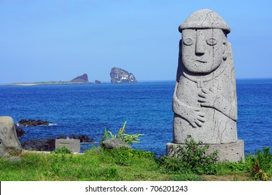 JEJU, SOUTH KOREA -20 JULY 2017- A Dol Hareubang Grandfather statue on Jeju Island in the Jeju Special Administrative Province. These large volcanic rock statues are found throughout Jeju.
