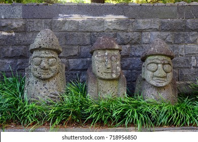 JEJU, SOUTH KOREA -20 JULY 2017- Two Dol Hareubang Grandfather statues on Jeju Island in the Jeju Special Administrative Province. These large volcanic rock statues are found throughout Jeju.