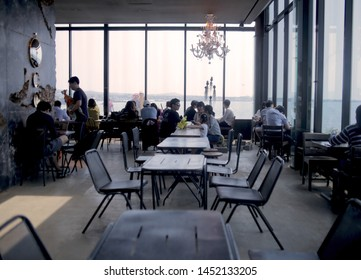 Jeju, South Korea - Circa May 2017: Empty table in Monsant Cafe surround with people