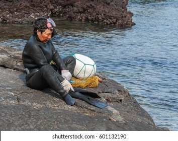 JEJU, SOUTH KOREA - MAR 27: Haenyo diver woman at a traditional Korean village at Jeju island, South Korea on Mar 27, 2011