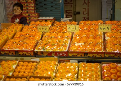 Jeju, South Korea - March 15 2017: The store in Dongmun market selling orange, which is the famous fruit on Jeju island.