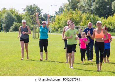 Jelgava, Latvia 15,2017, a group of ten people running barefoot