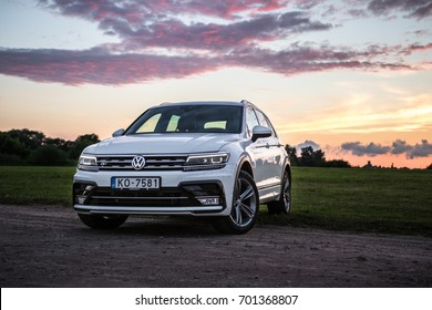Jelgava, Latvia - August 20, 2017: Outdoor photo of second generation Volkswagen Tiguan, 4x4 R-Line. white compact crossover car SUV manufactured by Volkswagen stands on off road sunset