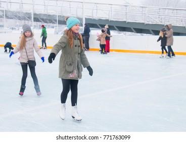Jelgava, Latvia, January 13, 2017,two girls on skates, on an open skating rink