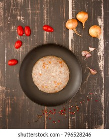 Jellied meat (chicken, pork and beef) on wooden background
