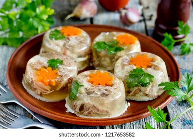 Jellied meat kholodets, meat aspic with vegetables and green parsley