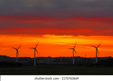 Jelling, Denmark. Aug 25, 2018. Windmills in sunset. Windpower now (2018) provides over 40 percent of all electric power in Denmark. Most European countries increasingly produce green power.