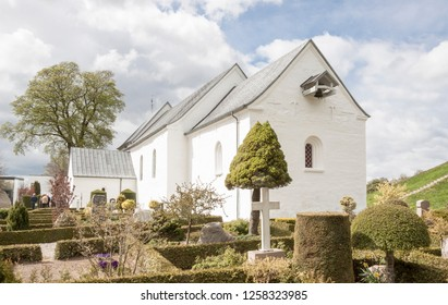 JELLING, DENMARK - MAY 9, 2017:  White church on the monument area which enjoys UNESCO World Heritage patronage on may 9, 2017 in Jelling, Denmark.
