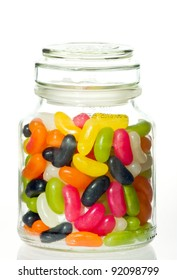 Jelly bean sugar candy snack in stylish glass jar  isolated on white