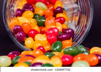 Jelly beans coming out of a jar - close up