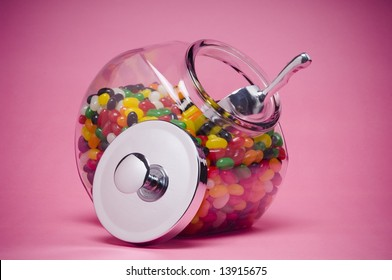 Jelly beans in glass container with metal lid off