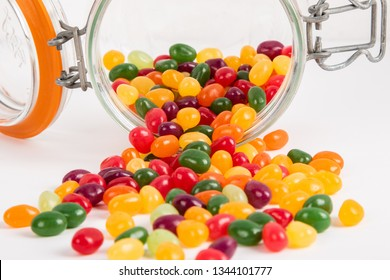 Jelly beans in a jar on white background