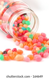 jelly beans spilling from a glass jar