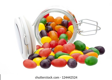Jelly beans spilling out of a glass jar
