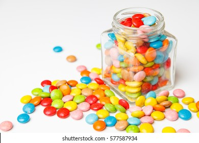 Jelly beans sugar candy snack in a jar on white