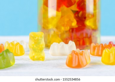 jelly candy or multivitamins closeup on the table on blue background