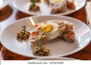 Jelly with carrots, rabbit meat and egg served with truffle spiced butter