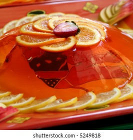 Jelly gelatine dessert dish served with sliced oranges