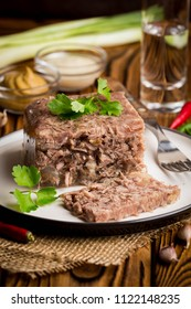 Jelly with meat, beef aspic, traditional Russian dish, portion on a plate, mustard and horseradish