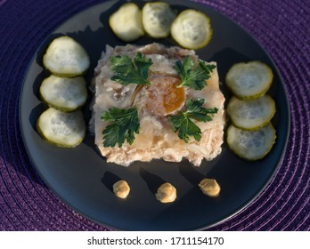 jelly on a plate with mustard and pickles