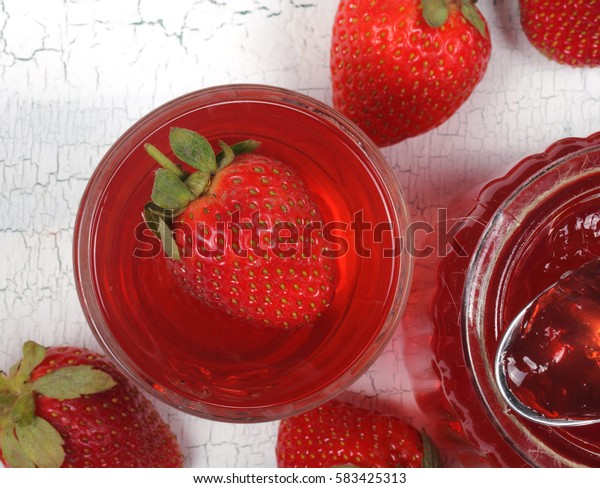 jelly strawberry standing on the bank next to the table attributes and strawberries