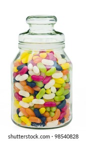Jellybeans in a glass candy jar with white background and clipping path.