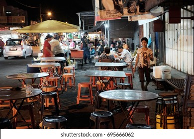 JELUTONG, PENANG, MALAYSIA - JUL 26, 2017: Outdoor dining facilities in Lorong Batu, Jelutong, Penang. Penang is cited as one of the top street food destination in the world.