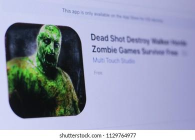 JEMBER, EAST JAVA, INDONESIA, JULY 09, 2018. Dead Shot Destroy Walker Horde Zombie Games Survivor Free app in play store. close-up on the laptop screen.
