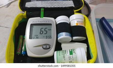 Jember - East Java - Indonesia, July 02 2019 :  Hypoglycemia Blood Sugar Level, Glucometer