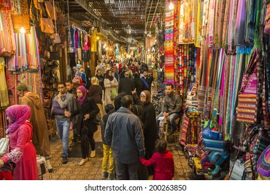 JEMMA DAR FNA, THE MAIN BAZAAR, MARRAKECH, MOROCCO, MAY 11, 2014. People walking on a corridor surrounded by booths and stalls in Jemma Dar Fna, Marrakech, Morocco, on May 11th, 2014.