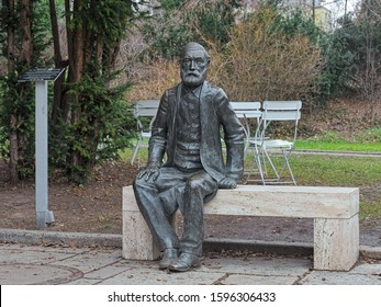 JENA, GERMANY - DECEMBER 15, 2018: Sculpture of physicist, optical scientist and inventor Ernst Abbe next to the Jena Planetarium. The monument by Klaus-Dieter Locke was unveiled on January 23, 2015.