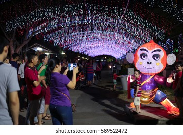 JENJAROM, MALAYSIA - 16 FEB 2016 : Family taking photo in front the LED light chinese zodiac replica of monkey at Fo Guang Shan temple, Jenjarom, Malaysia.