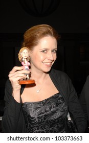 """Jenna Fischer and her own bobble-head at Kitten Rescue's """"Fur Ball at the Skirball"""" celebrating 10,000 cats saved, Skirball Center, Los Angeles, CA. 12-05-09"""