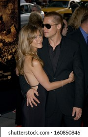 Jennifer Aniston and Brad Pitt attend the US Premiere of TROY at the Ziegfeld Theater May 10, 2004 in New York City